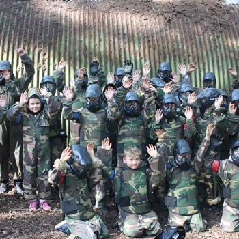 Team of kids at paintball park