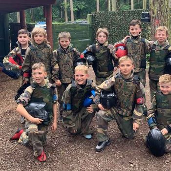 Kids celebrating victory of paintball game