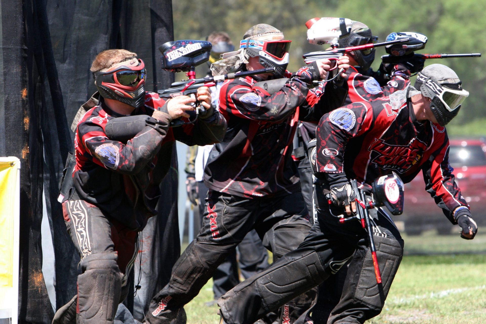 A team is playing paintball and learning how to play paintball for the first time